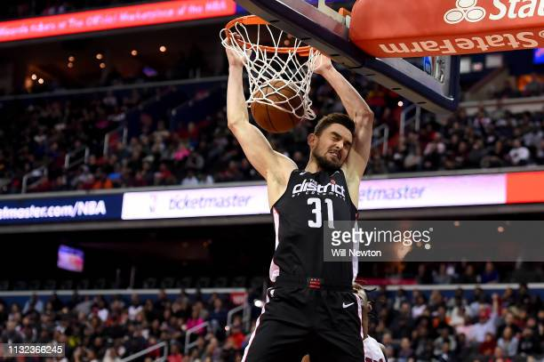 Tomas Satoransky of the Washington Wizards dunks against the Miami Heat during the second half at Capital One Arena on March 23 2019 in Washington DC...