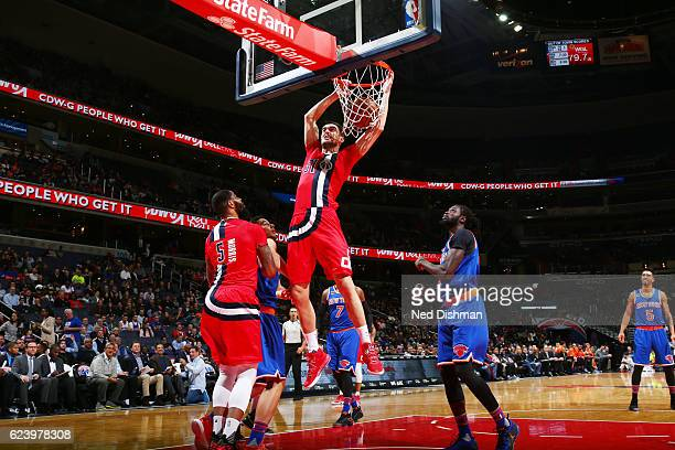 Tomas Satoransky of the Washington Wizards dunks against the New York Knicks during the game on November 17 2016 at Verizon Center in Washington DC...