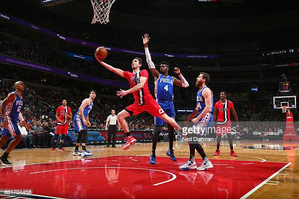 Tomas Satoransky of the Washington Wizards goes to the basket against the Philadelphia 76ers on January 14 2017 at Verizon Center in Washington DC...
