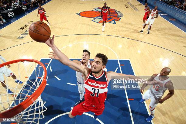 Tomas Satoransky of the Washington Wizards goes to the basket against the New York Knicks on October 13 2017 at Madison Square Garden in New York...