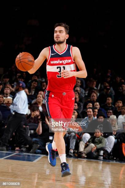 Tomas Satoransky of the Washington Wizards handles the ball against the New York Knicks on October 13 2017 at Madison Square Garden in New York City...