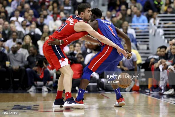 Tomas Satoransky of the Washington Wizards knocks the ball from Reggie Jackson of the Detroit Pistons in the second half at Capital One Arena on...