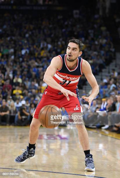 Tomas Satoransky of the Washington Wizards passes the ball against the Golden State Warriors during an NBA Basketball game at ORACLE Arena on April 2...
