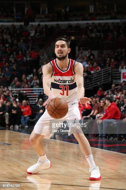 Tomas Satoransky of the Washington Wizards passes the ball against the Chicago Bulls on February 10 2018 at the United Center in Chicago Illinois...