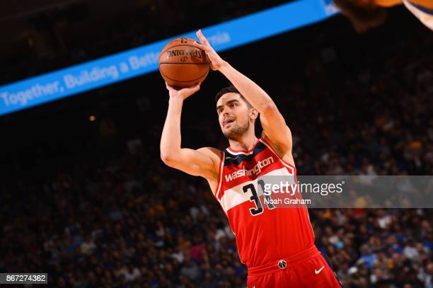 Tomas Satoransky of the Washington Wizards shoots the ball against the Golden State Warriors on October 27 2017 at ORACLE Arena in Oakland California...