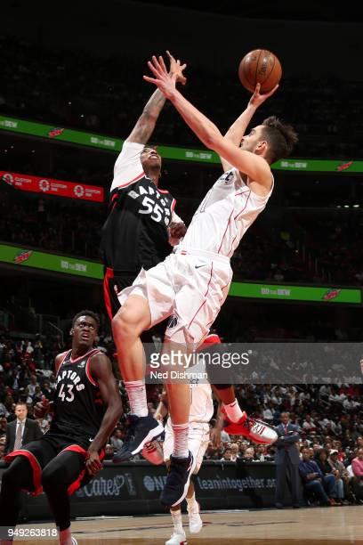 Tomas Satoransky of the Washington Wizards shoots the ball around Delon Wright of the Toronto Raptors in Game Three of Round One of the 2018 NBA...