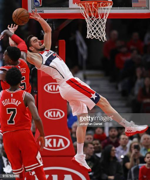 Tomas Satoransky of the Washington Wizards suffers a flagrant foul by Bobby Portis of the Chicago Bulls late in the game at the United Center on...