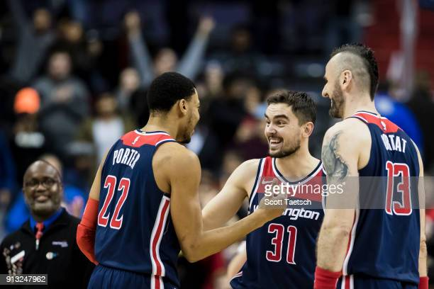 Tomas Satoransky Otto Porter Jr #22 and Marcin Gortat of the Washington Wizards celebrate at the end of the game against the Toronto Raptors at...