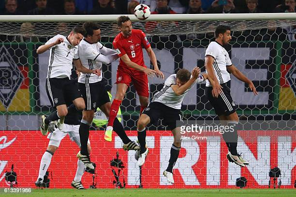 Tomas Sivok of Czech Republic jumps for a header with Julian Draxler Mats Hummels Thomas Mueller and Sami Khedira of Germany during the FIFA World...