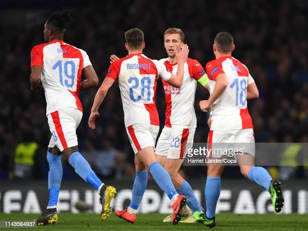 Tomas Soucek of SK Slavia Praha celebrates with teammates after scoring his team's first goal during the UEFA Europa League Quarter Final Second Leg...