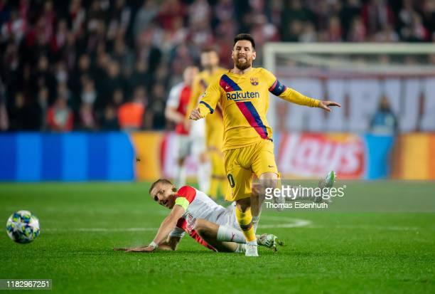 Tomas Soucek of Slavia Praha is challenged by Lionel Messi of Barcelona during the UEFA Champions League group F match between Slavia Praha and FC...