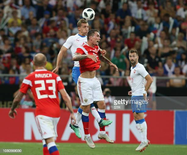 Tomas Soucek of the Czech Republic and Russia's Anton Zabolotny vie for the ball during the international friendly football match between Russia and...