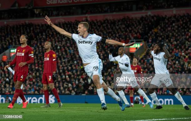 Tomas Soucek of West Ham United celebrates their first goal during the Premier League match between Liverpool FC and West Ham United at Anfield on...