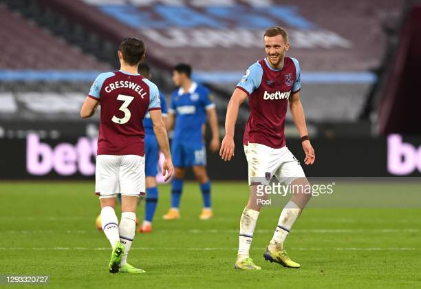 Tomas Soucek of West Ham United celebrates with Aaron Cresswell after scoring their team's second goal during the Premier League match between West...