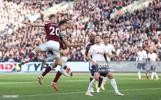 Tomas Soucek of West Ham United has a headed shot whilst under pressure from Eric Dier of Tottenham Hotspur during the Premier League match between...