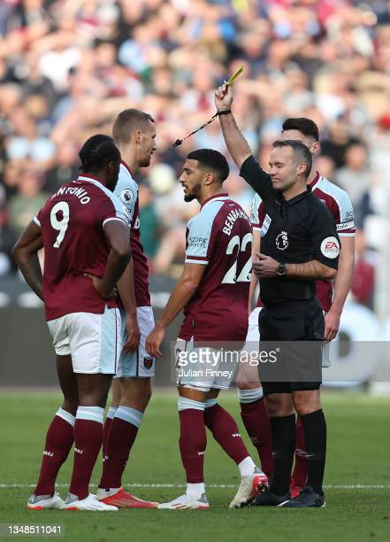 Tomas Soucek of West Ham United is shown a yellow card by Match Referee, Paul Tierney during the Premier League match between West Ham United and...