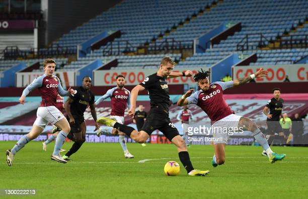 Tomas Soucek of West Ham United shoots past Tyrone Mings of Aston Villa to score during the Premier League match between Aston Villa and West Ham...