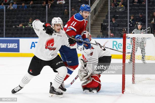 Tomas Soustal of the Edmonton Oil Kings battles against Dmitri Zaitsev of the Moose Jaw Warriors at Rogers Place on December 7 2017 in Edmonton Canada