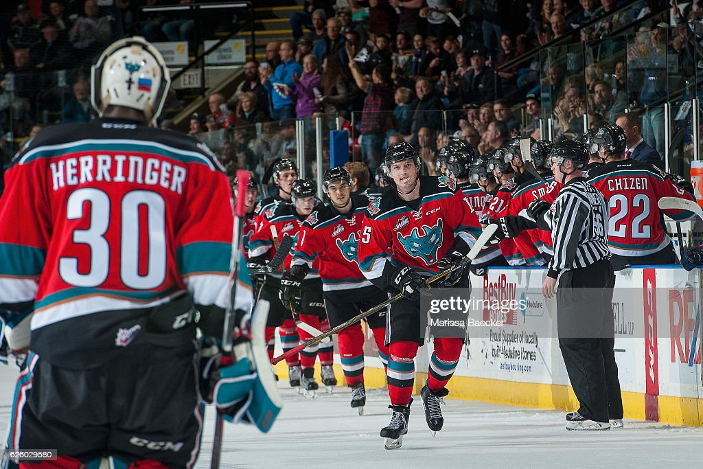 Tomas Soustal #15 of the Kelowna Rockets skates by the bench to goalie Michael Herringer #30 as he celebrates a second period goal against the Regina Pats on November 26, 2016 at Prospera Place in Kelowna, British Columbia, Canada.