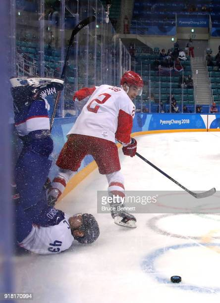 Tomas Surovy of Slovakia runs in to the boards after colliding with Artyom Zub of Olympic Athlete from Russia in the third period during the Men's...