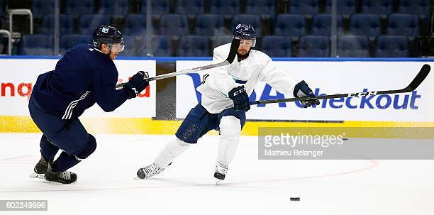 Tomas Tatar and Jannik Hansen battle for the puck during a practice at the Centre Videotron on September 7, 2016 in Quebec City, Quebec, Canada.