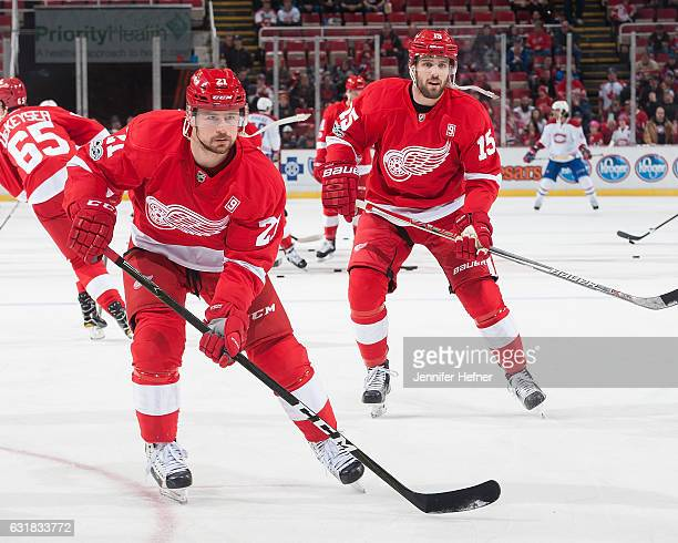 Tomas Tatar and Riley Sheahan of the Detroit Red Wings warmup prior to an NHL game at Joe Louis Arena on January 16 2017 in Detroit Michigan