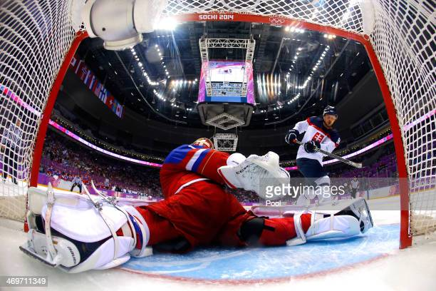 Tomas Tatar of Slovakia misses a shot against Semyon Varlamov of Russia in a shoot out during the Men's Ice Hockey Preliminary Round Group A game on...