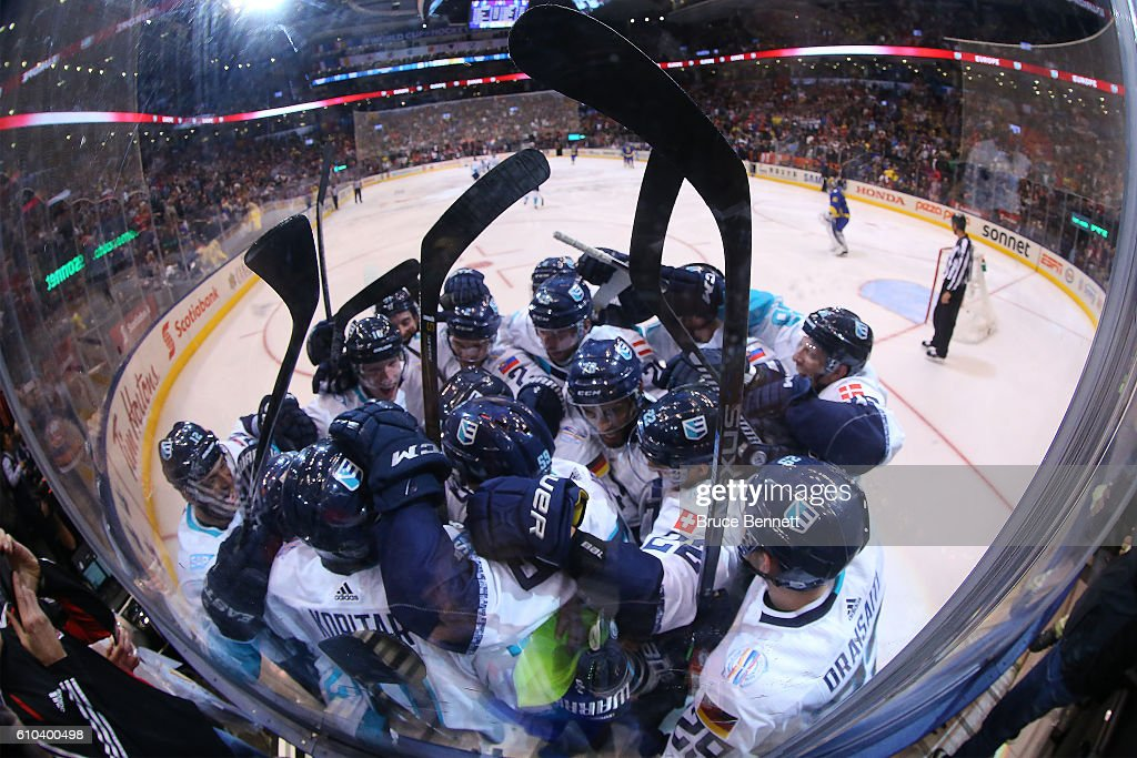Tomas Tatar #21 of Team Europe is congratulated by his teammates after scoring the game winning goal in overtime against Team Sweden at the semifinal game during the World Cup of Hockey tournament at Air Canada Centre on September 25, 2016 in Toronto, Canada. Team Europe defeated Team Sweden 3-2.