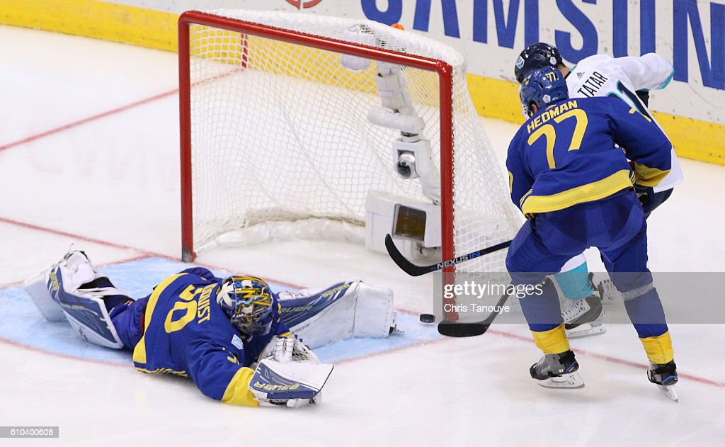 Tomas Tatar #21 of Team Europe scores the game winning goal in overtime past a defending Henrik Lundqvist #30 and Victor Hedman #77 of Team Sweden at the semifinal game during the World Cup of Hockey tournament at Air Canada Centre on September 25, 2016 in Toronto, Canada. Team Europe defeated Team Sweden 3-2.