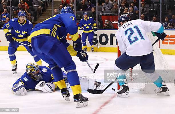 Tomas Tatar of Team Europe scores the game winning goal in overtime past a defending Henrik Lundqvist and Victor Hedman of Team Sweden at the...