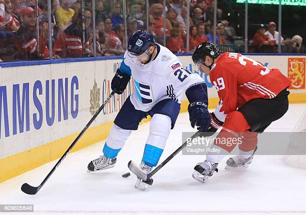 Tomas Tatar of Team Europe stickhandles the puck against Logan Couture of Team Canada during the World Cup of Hockey 2016 at Air Canada Centre on...
