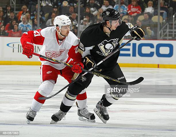 Tomas Tatar of the Detroit Red Wings battles for position against Adam Payerl of the Pittsburgh Penguins on April 9 2014 at Consol Energy Center in...