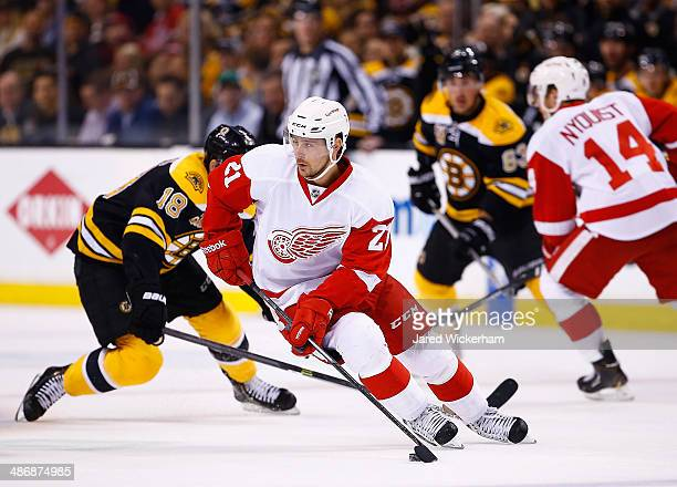 Tomas Tatar of the Detroit Red Wings carries the puck against the Boston Bruins in the first period in Game Five of the First Round of the 2014 NHL...