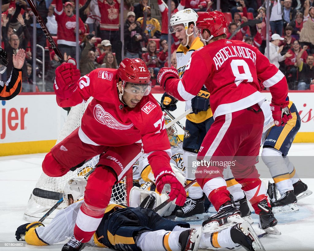 Tomas Tatar #21 of the Detroit Red Wings (not pictured) pokes in the puck for a third period goal on Juuse Saros #74 of the Nashville Predators as teammates Ryan Ellis #4 and Colton Sissons #10 defend against Andreas Athanasiou #72 and Justin Abdelkader #8 of the Wings during an NHL game at Little Caesars Arena on February 20, 2018 in Detroit, Michigan.
