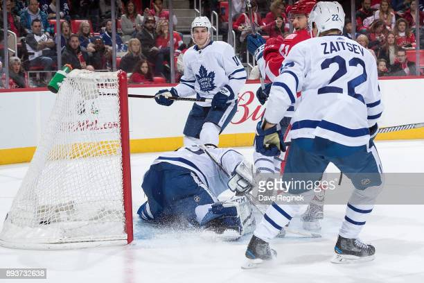 Tomas Tatar of the Detroit Red Wings scores a third period goal on Curtis McElhinney of the Toronto Maple Leafs as teammates Nikita Zaitsev and Zach...