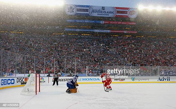 Tomas Tatar of the Detroit Red Wings shoots against Jonathan Bernier of the Toronto Maple Leafs during the 2014 Bridgestone NHL Winter Classic on...