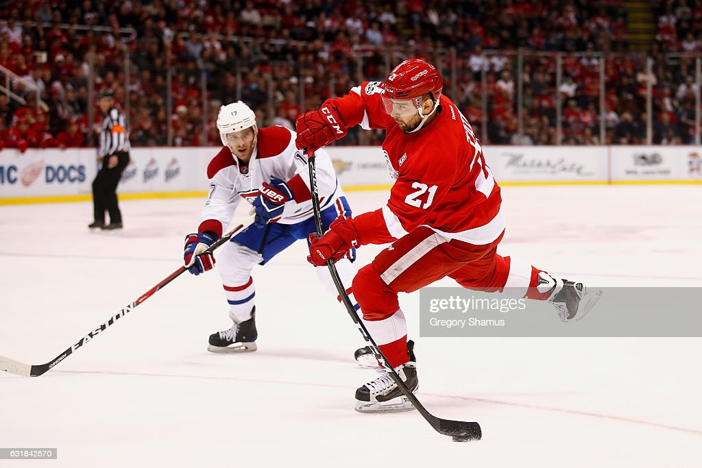 Tomas Tatar #21 of the Detroit Red Wings takes a third period shot in front of Torrey Mitchell #17 of the Montreal Canadiens at Joe Louis Arena on January 16, 2017 in Detroit, Michigan. Detroit won the game 1-0.