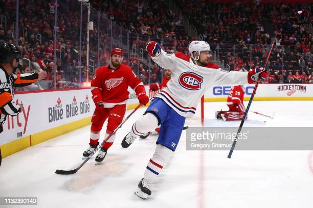 Tomas Tatar of the Montreal Canadiens celebrates his first period goal next to Filip Hronek of the Detroit Red Wings at Little Caesars Arena on...