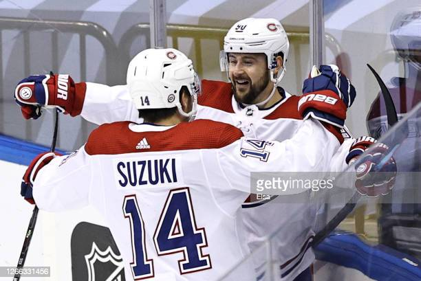 Tomas Tatar of the Montreal Canadiens celebrates with Nick Suzuki after scoring a goal on Carter Hart of the Philadelphia Flyers during the first...