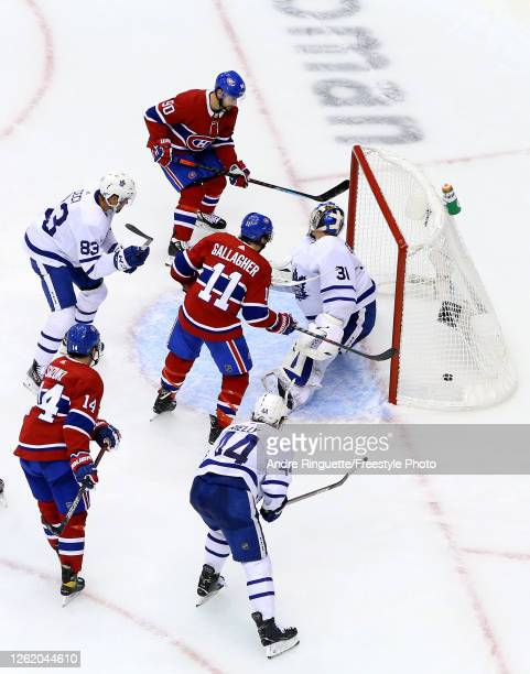 Tomas Tatar of the Montreal Canadiens gets the puck past Frederik Andersen of the Toronto Maple Leafs as Brendan Gallagher and Nick Suzuki of the...