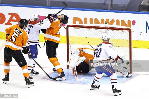 Tomas Tatar of the Montreal Canadiens scores a goal on Carter Hart of the Philadelphia Flyers during the first period in Game Two of the Eastern...