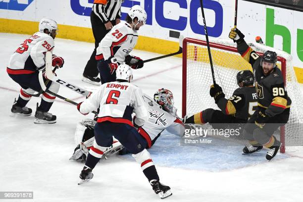 Tomas Tatar of the Vegas Golden Knights celebrates after assisting teammate David Perron on a secondperiod goal against Braden Holtby of the...