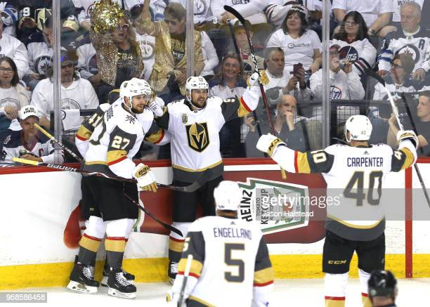 Tomas Tatar of the Vegas Golden Knights is congratulated by his teammates Shea Theodore Ryan Carpenter and PierreEdouard Bellemare after scoring a...