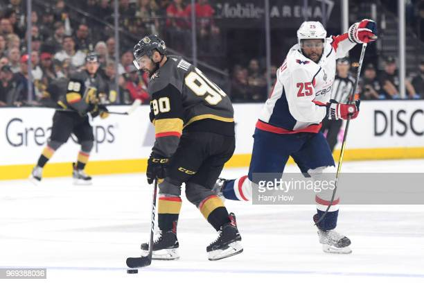 Tomas Tatar of the Vegas Golden Knights is defended by Devante SmithPelly of the Washington Capitals during the first period in Game Five of the 2018...