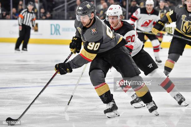 Tomas Tatar of the Vegas Golden Knights skates with the puck while Blake Coleman of the New Jersey Devils defends during the game at TMobile Arena on...