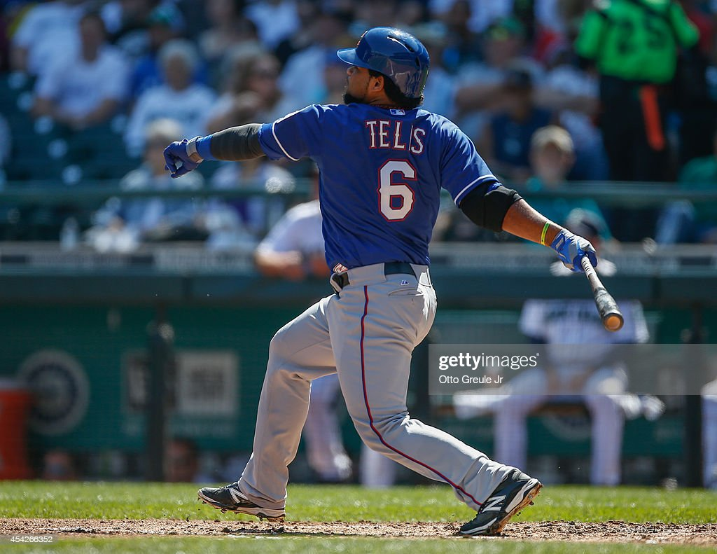 Tomas Telis #6 of the Texas Rangers hits a three-run RBI double in the second inning against the Seattle Mariners at Safeco Field on August 27, 2014 in Seattle, Washington. The Rangers defeated the Mariners 12-4.