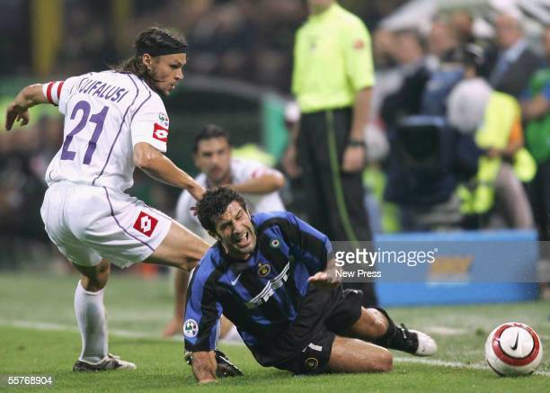 Tomas Ujfalusi of Fiorentina tackles Luis Figo of Inter during the Serie A match between Inter Milan and Fiorentina at the San Siro Stadium on...