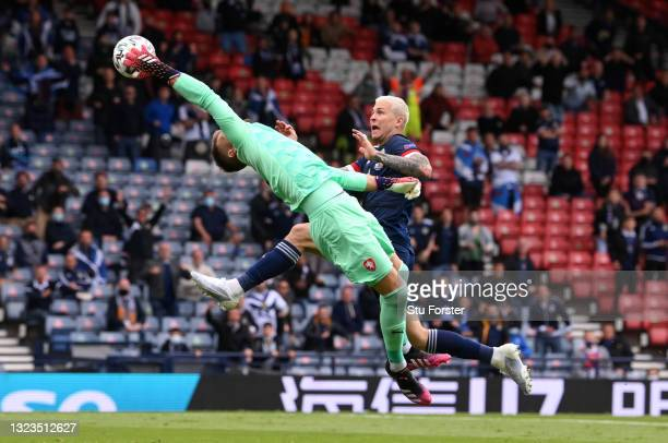 Tomas Vaclik of Czech Republic makes a save from Lyndon Dykes of Scotland during the UEFA Euro 2020 Championship Group D match between Scotland v...