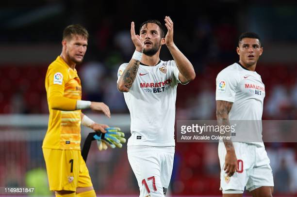 Tomas Vaclik of Sevilla FC celebrates after win the match against Granada CF with Diego Carlos and Nemanja Gudelj during the Liga match between...
