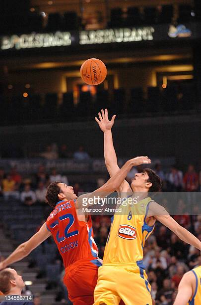 Tomas Van Den Spiegel of CSKA Moscow and Lior Eliyahu of Macabbi Tel Aviv contest the opening tip of the game at the NBA Europe Live Tour presented...
